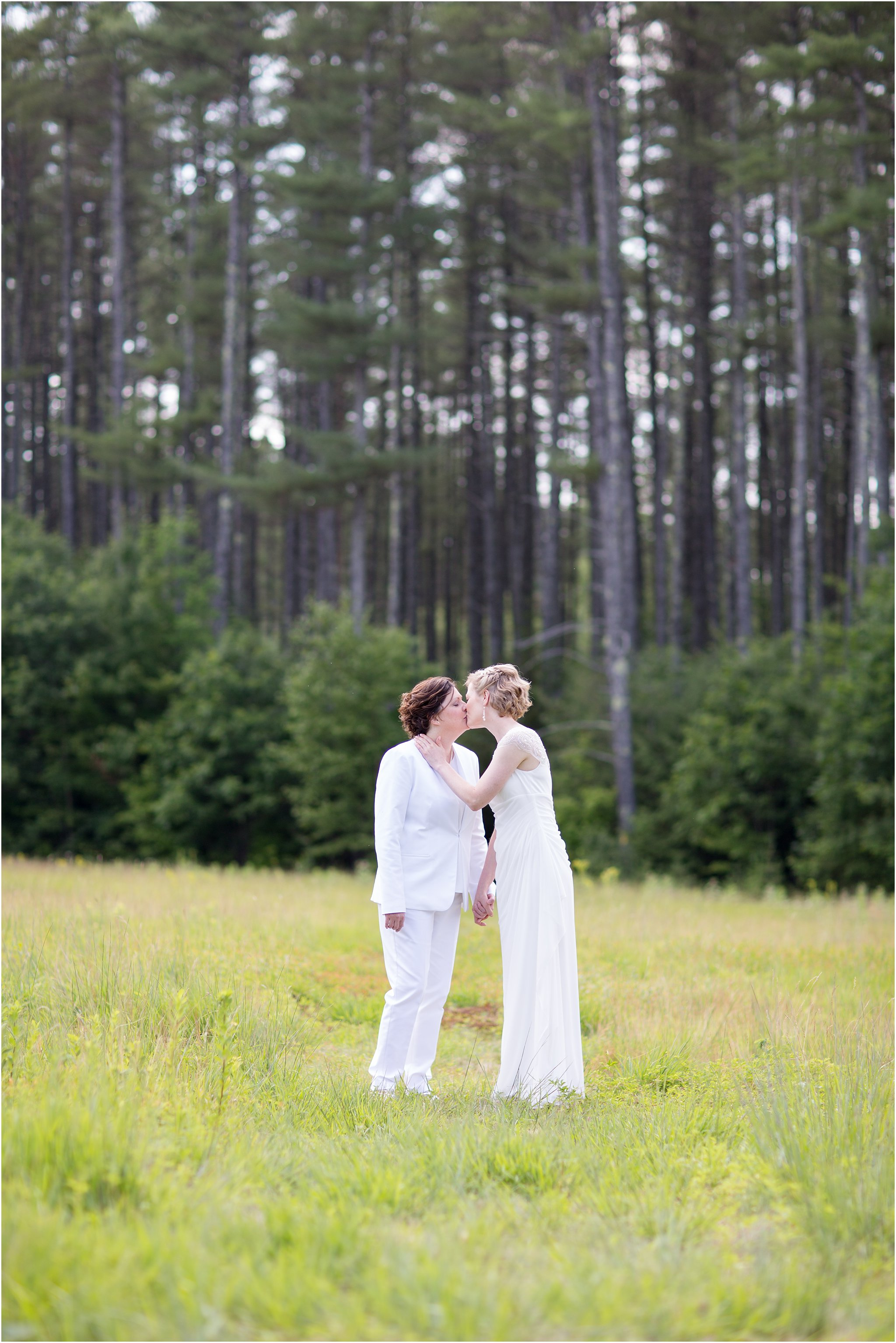 Two brides kissing