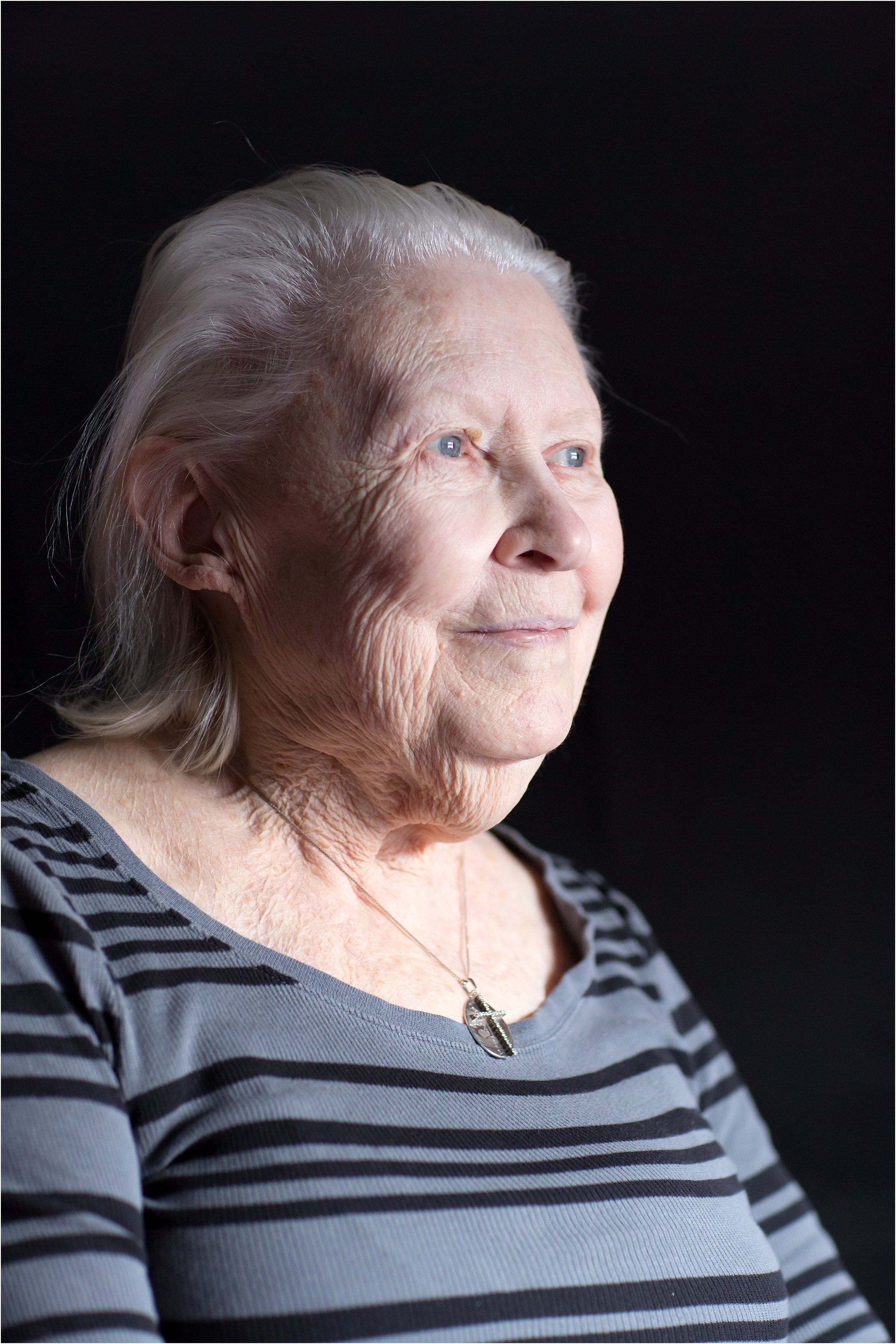Portrait of Elderly Woman with Black Background