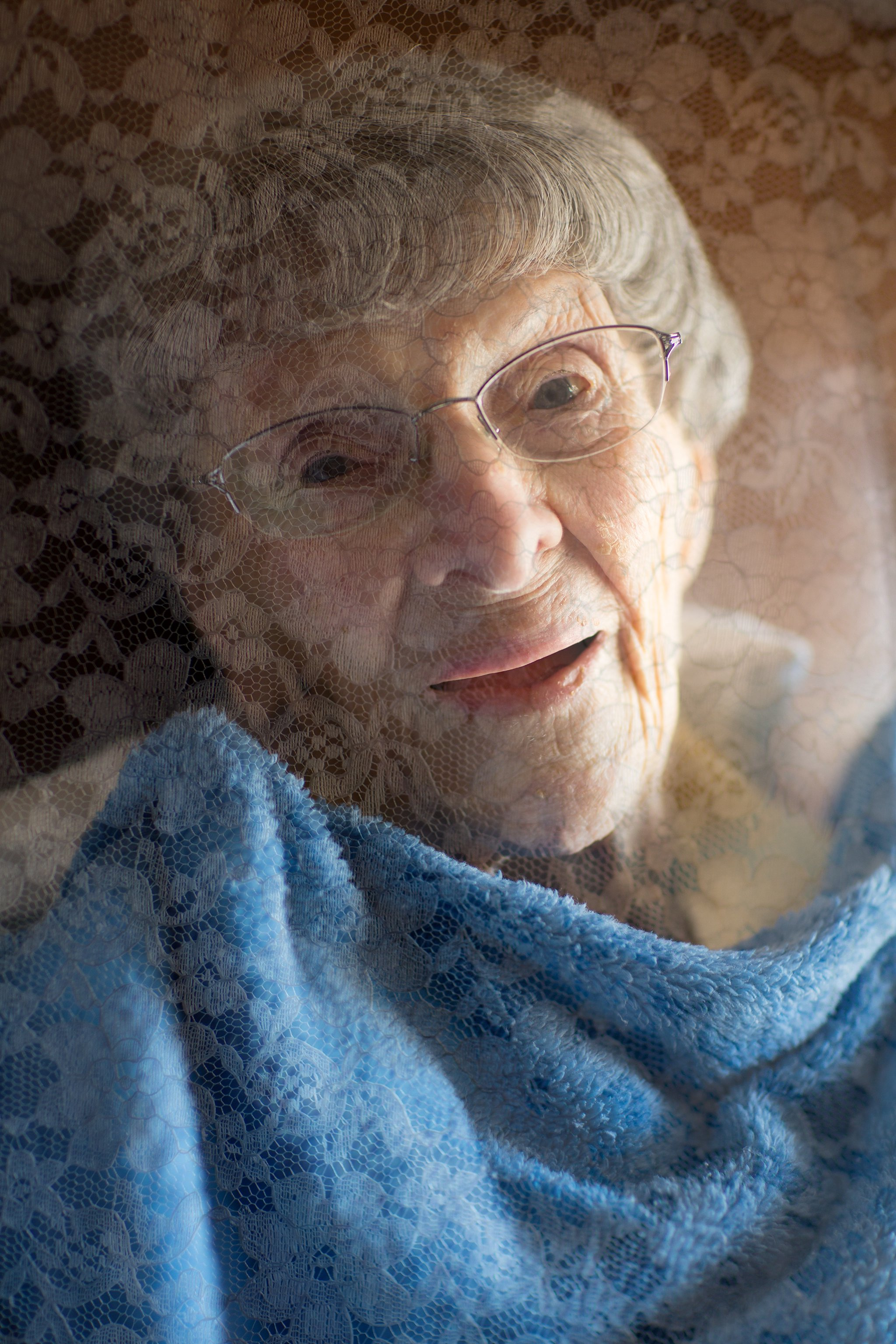 Portrait of Elderly Woman, Photographed Through Lace