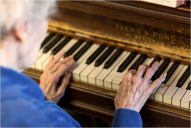 elderly woman playing piano