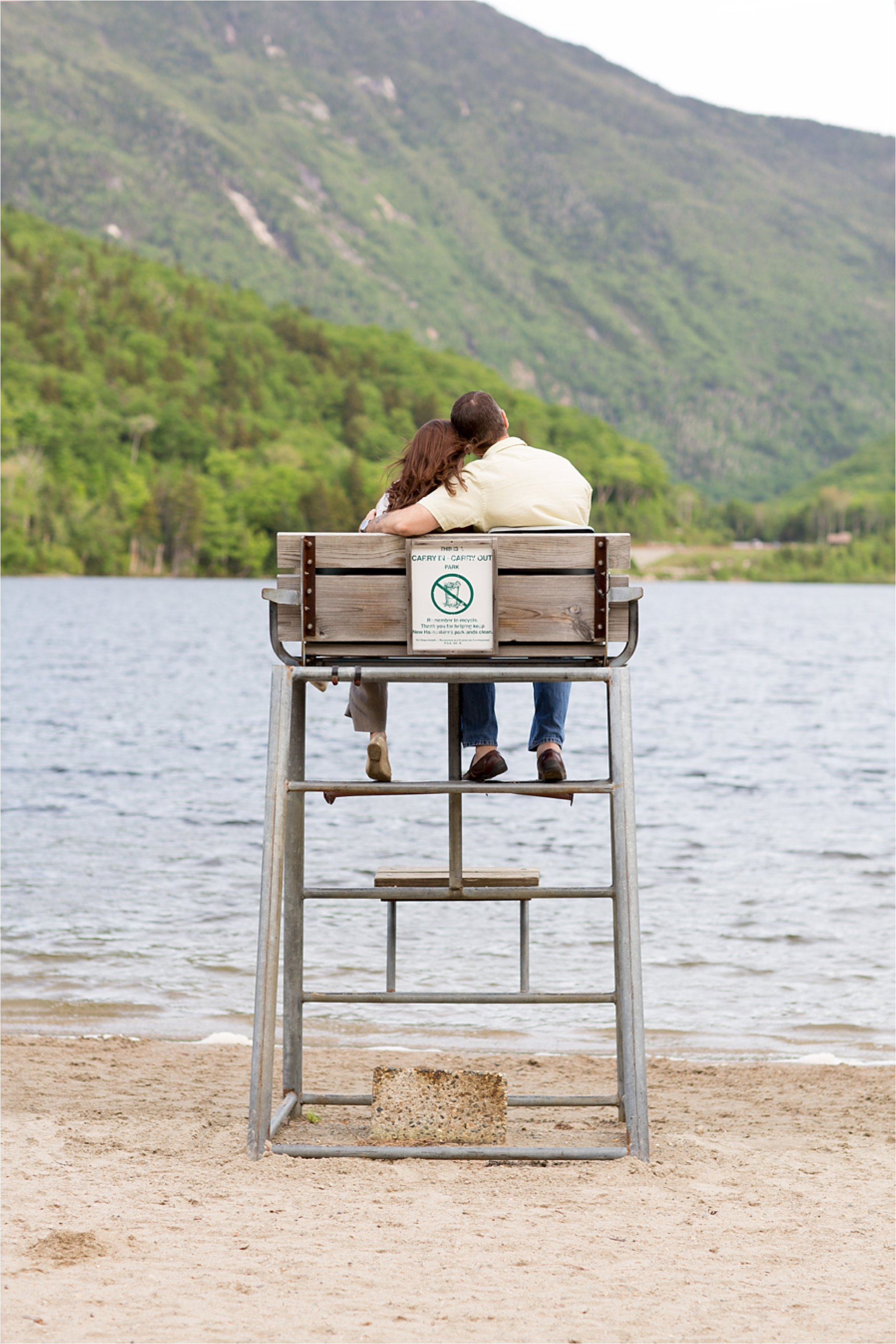 engaged couple in lifeguard chair