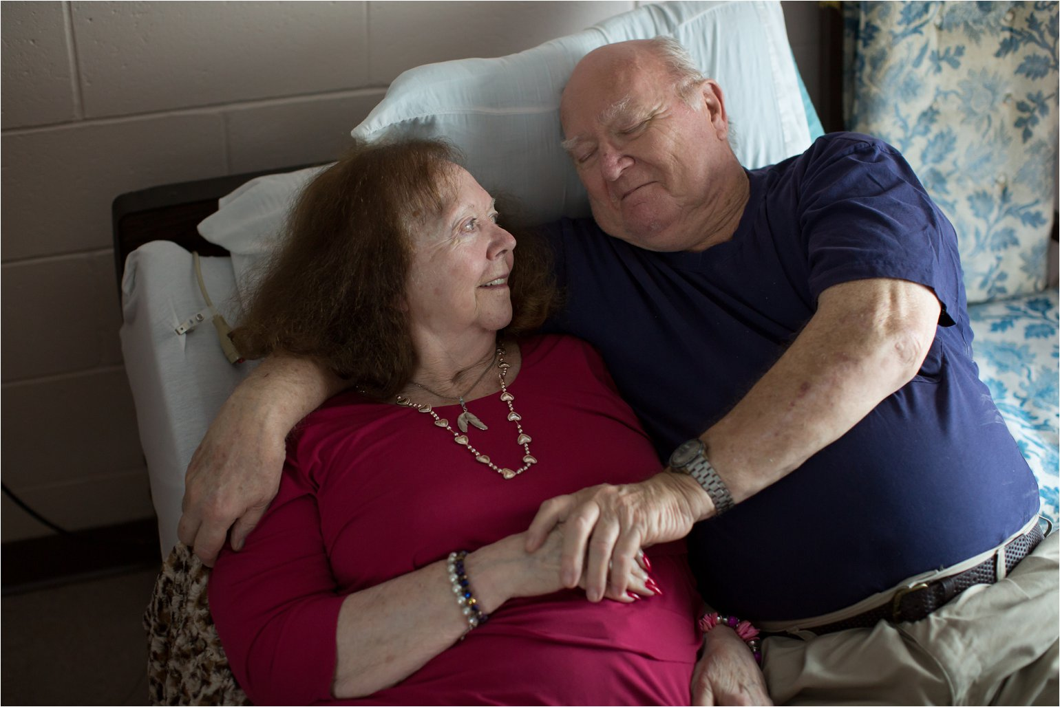 Elderly Couple Lying on Bed (C) Maundy Mitchell