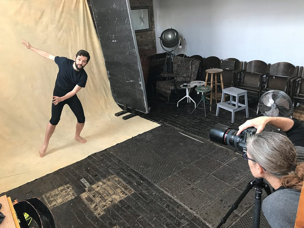 Behind the scenes cell pic of photographer Maundy Mitchell working with London mime Ramon Ayres.