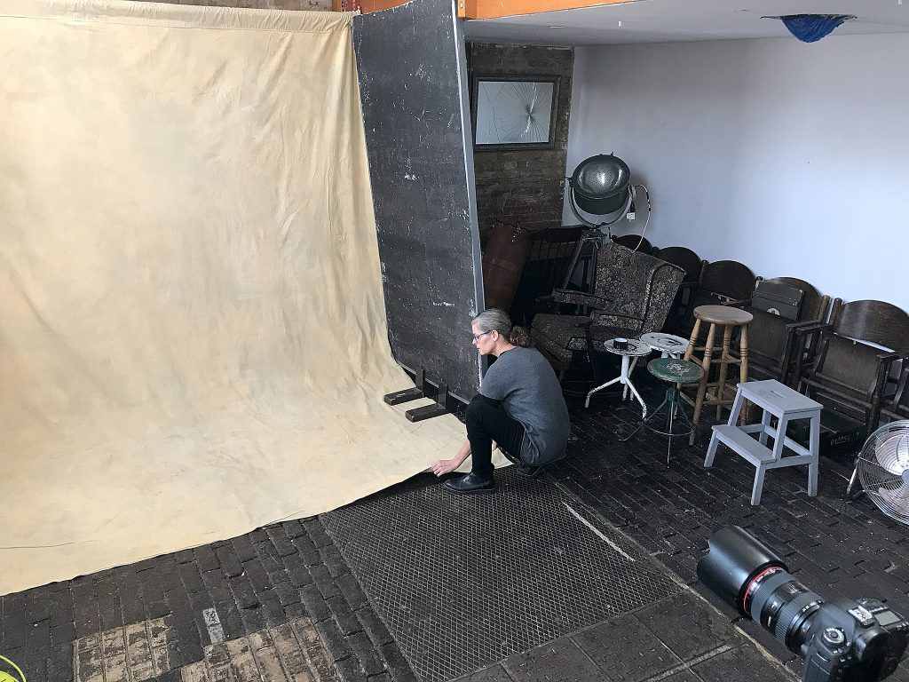 Photographer Maundy Mitchell setting up for personal project Life's Work at Espero Studio in London.