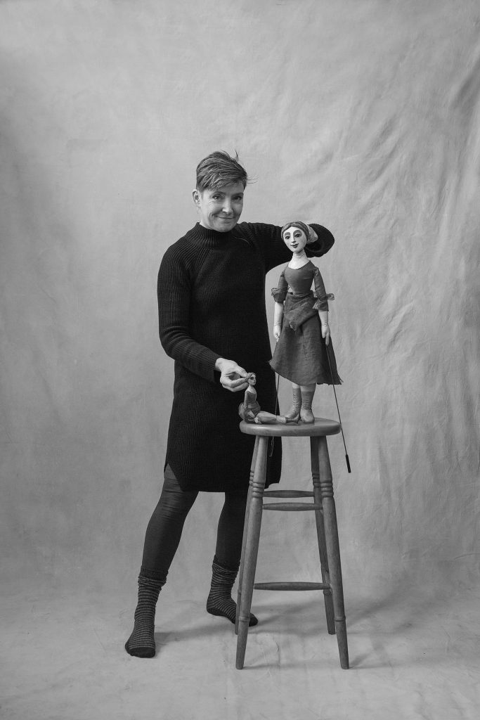 Sarah Wright with a large and a small puppet
