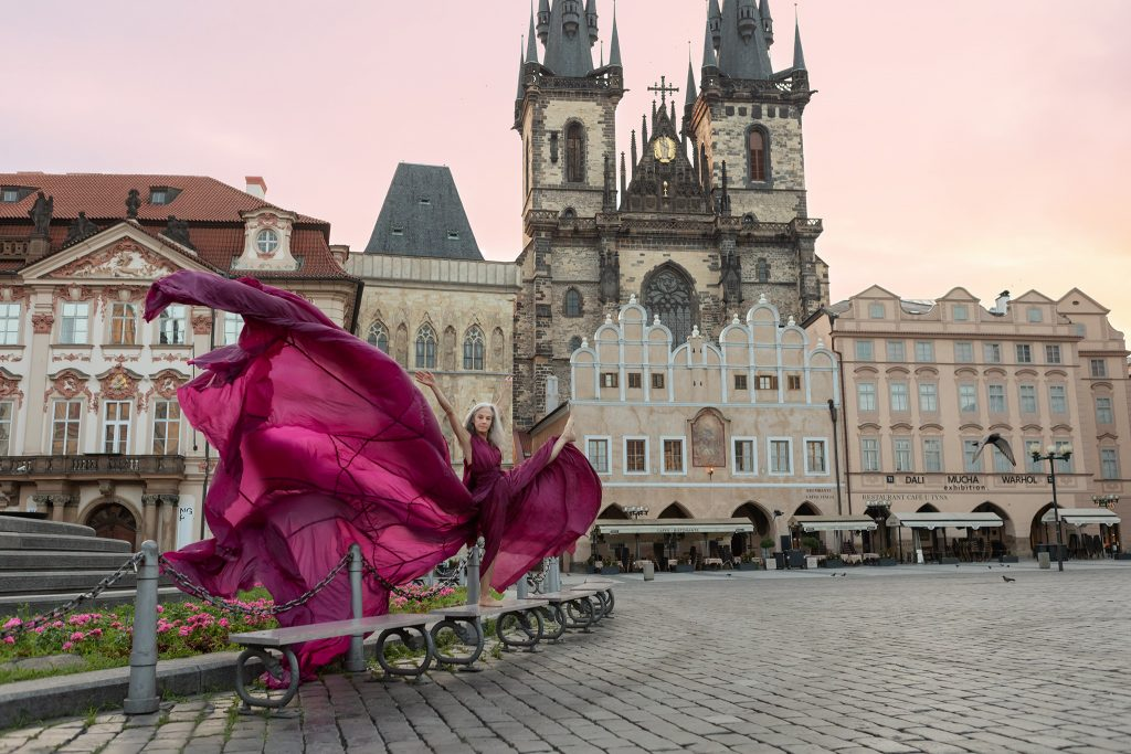 Dancer Lisa Travis in front of the Church of Our Lady before Týn, Old Town Square, Prague