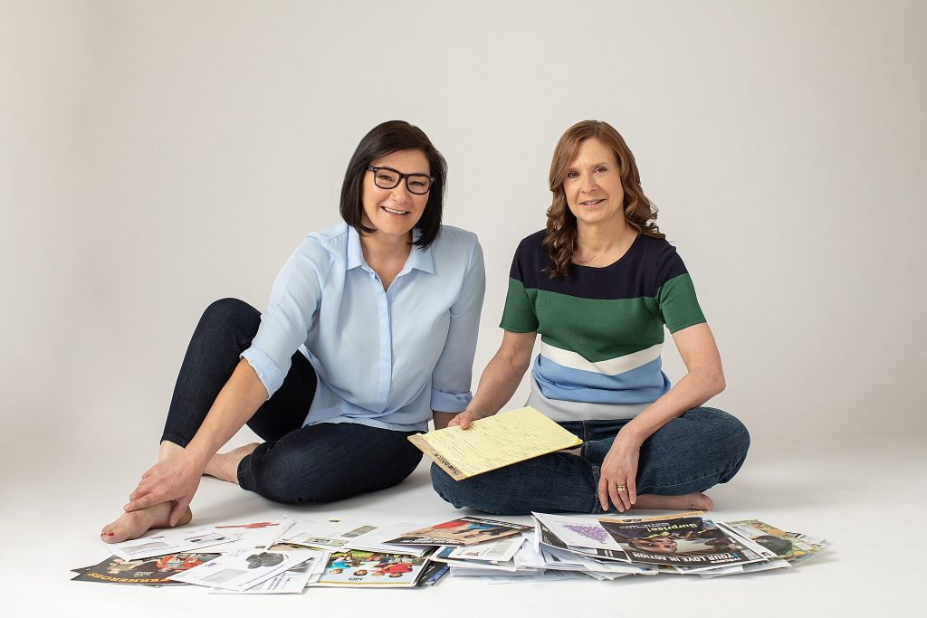 Business Portrait of Lisa and Sandie, Sitting, with Mail