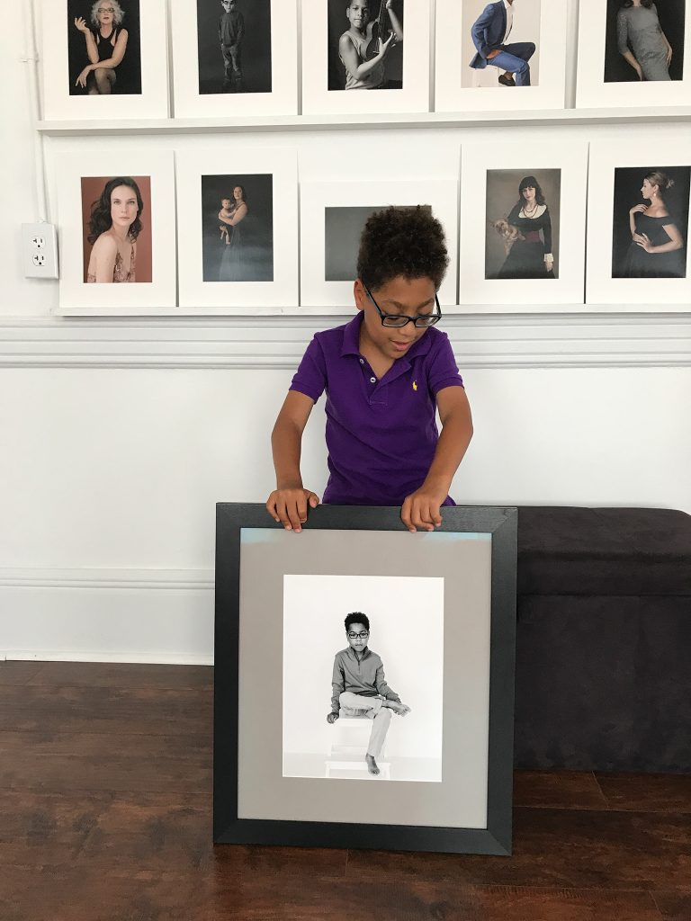 Liam with framed print of himself