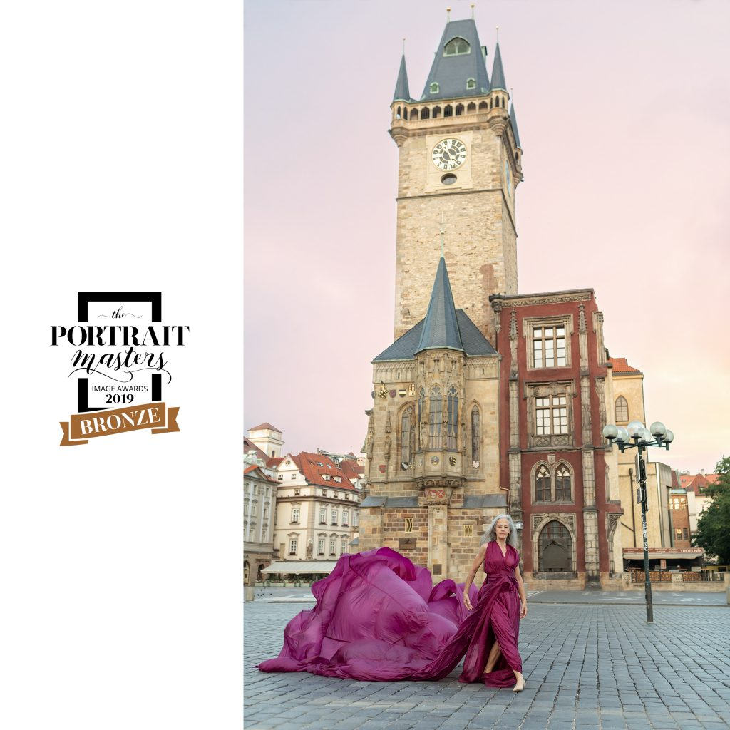 Portrait of a dancer with flowy pink dress in Old Town Square, Prague.  Bronze award in contemporary portraiture: Lisa in Prague.