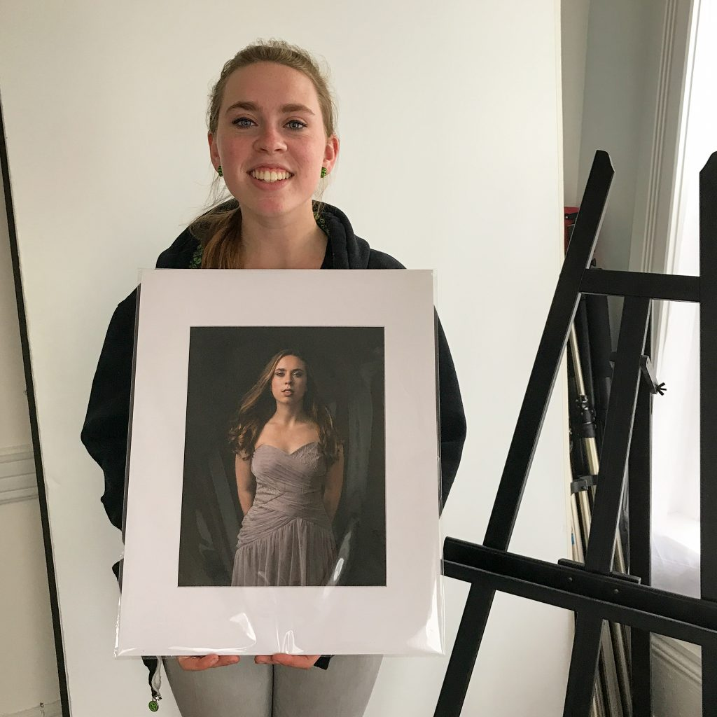 Kenzie, with one of her portraits at her Print Reveal Session.