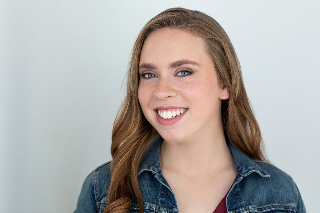 Acting headshot with light background for high school senior, Kenzie