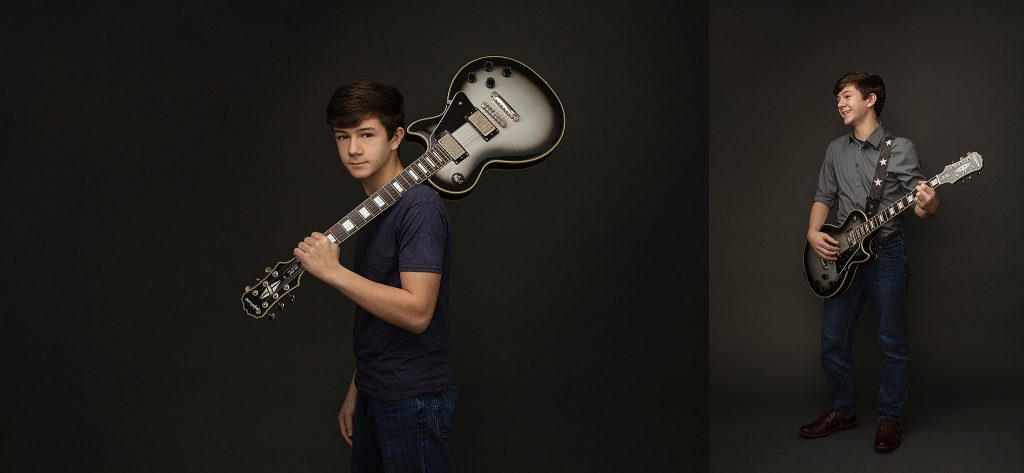 portrait of teenage boy with electric guitar