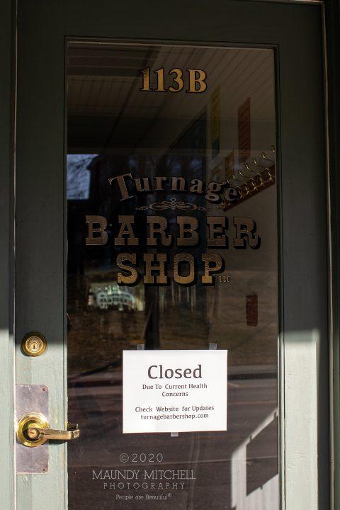 Sign on barber shop door
