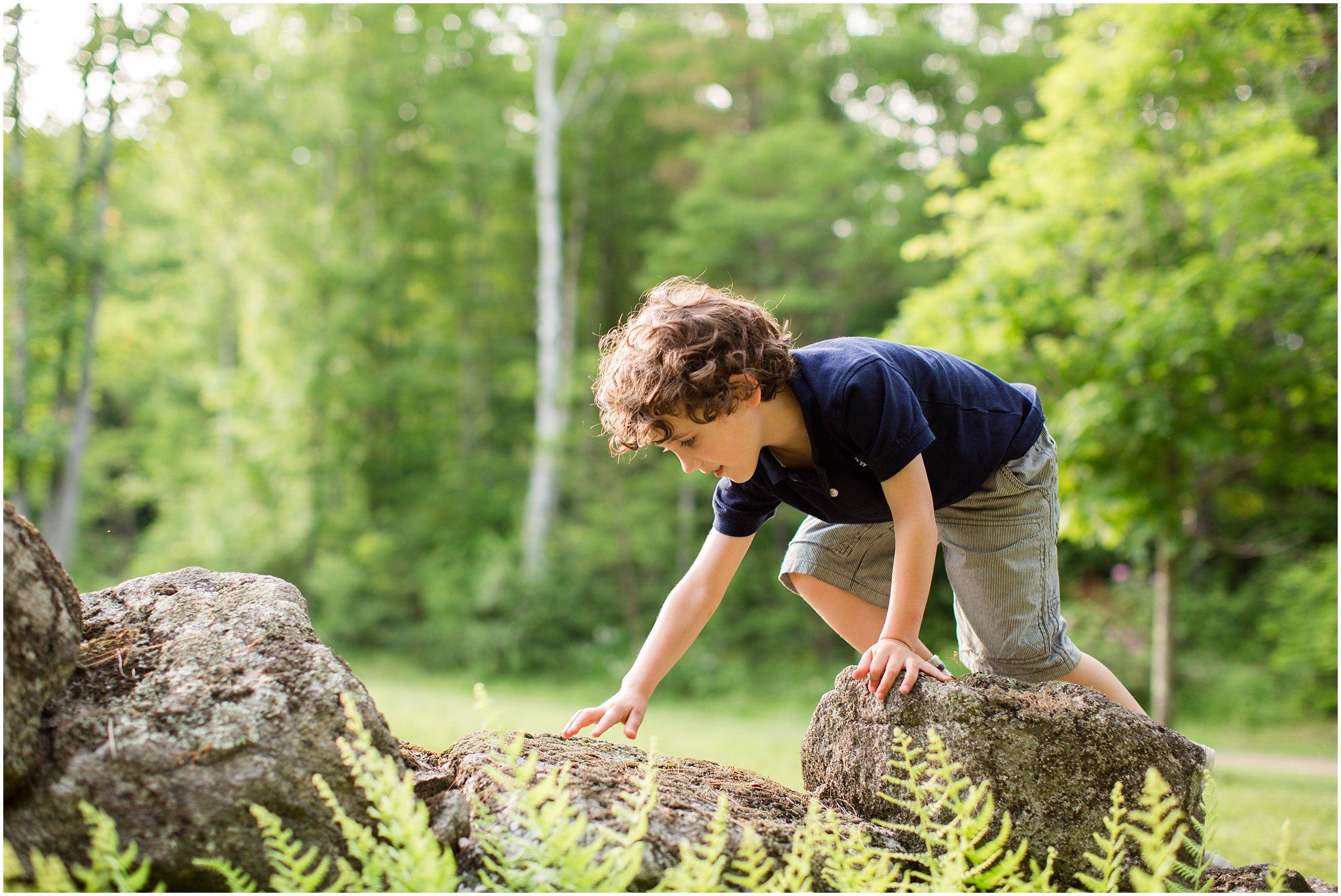 boy climbing stone wall 2