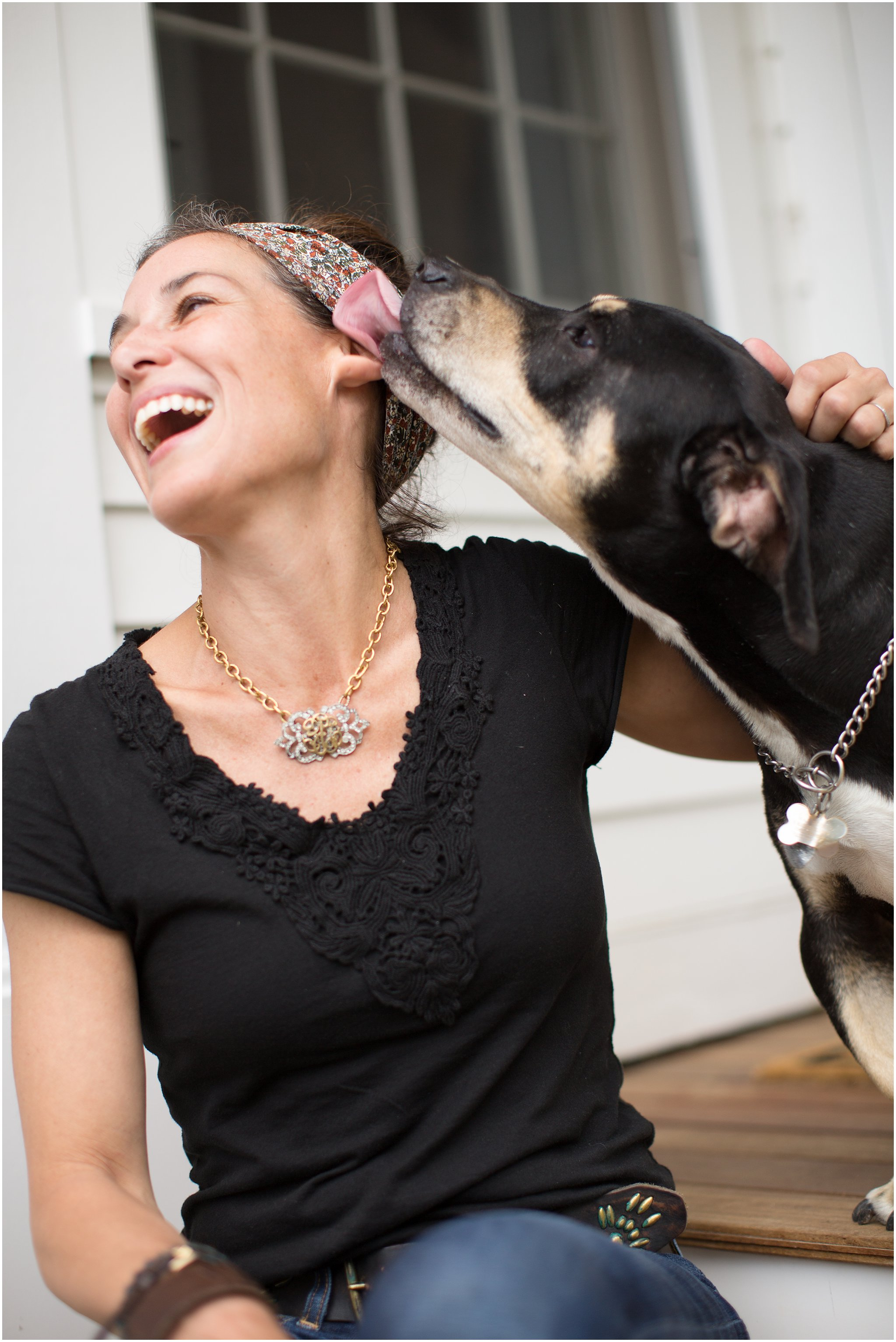 dog kissing woman