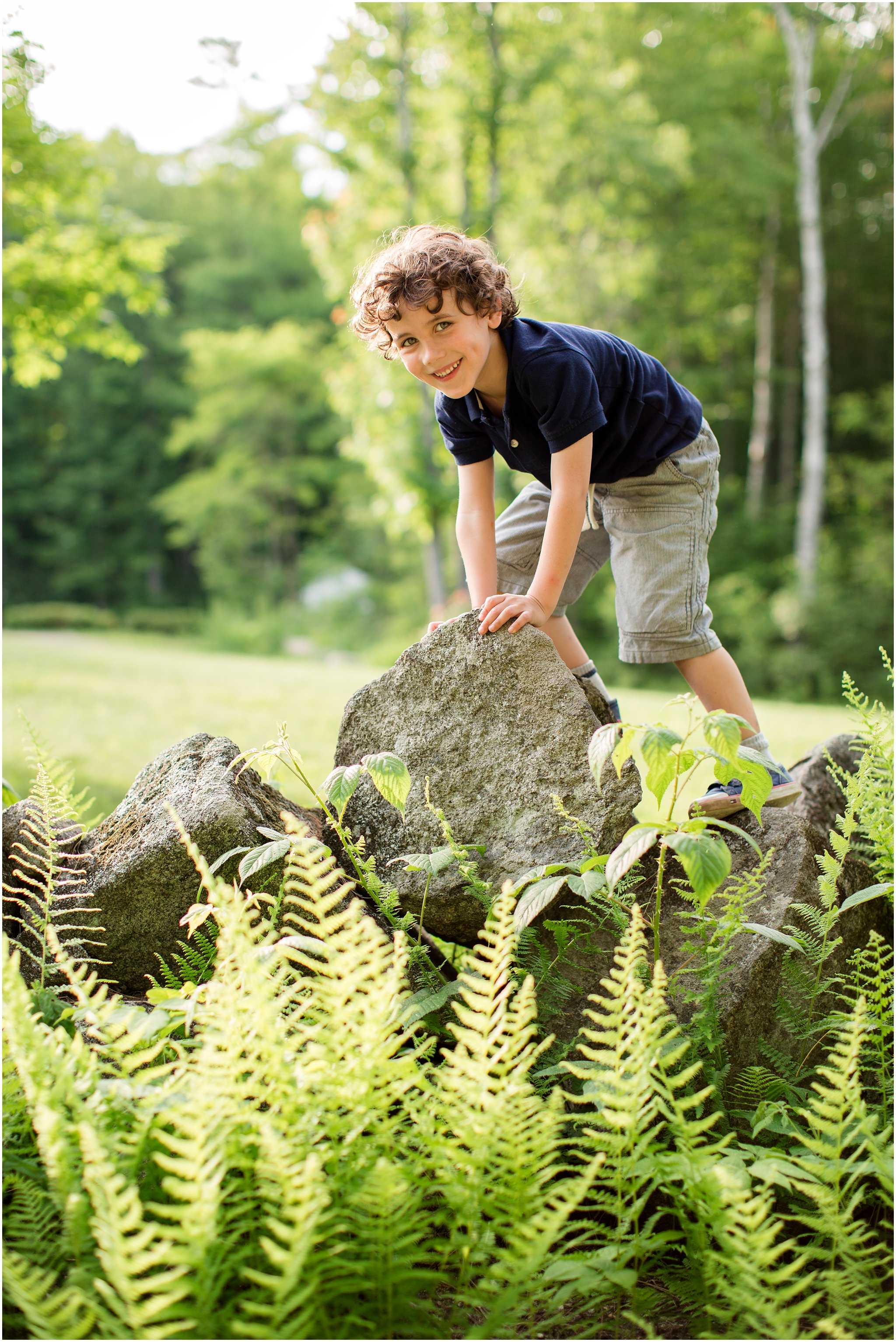 Boy climbing stone wall