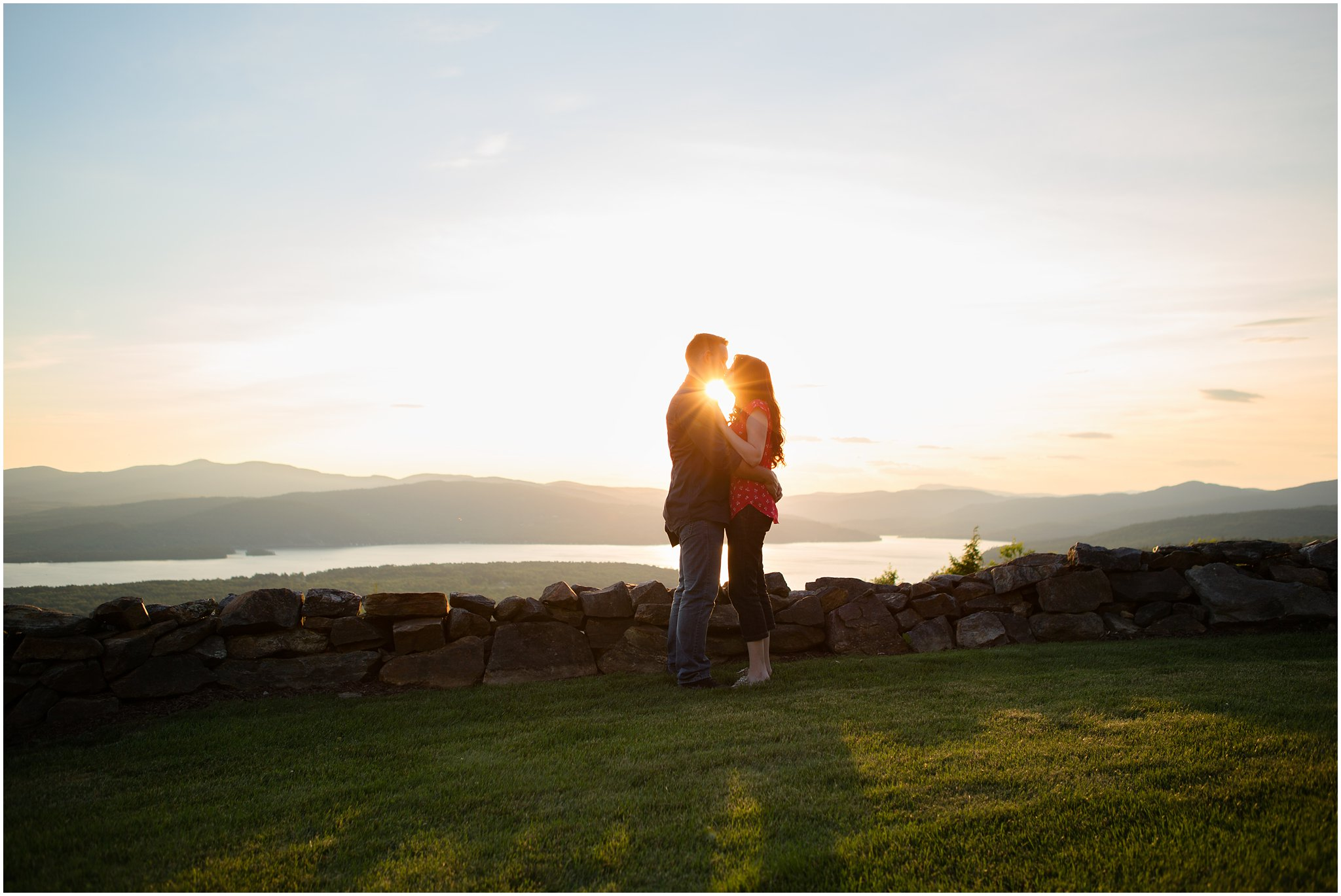 Couple Kissing at Sunset with Sunflare