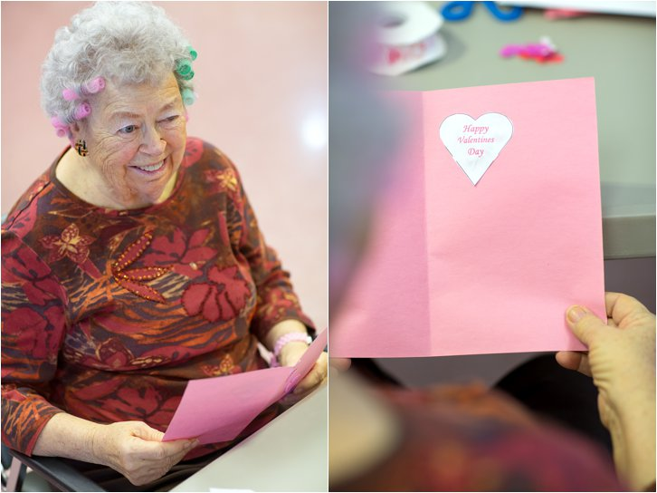 Elderly woman with hair curlers and a Valentine's Day card