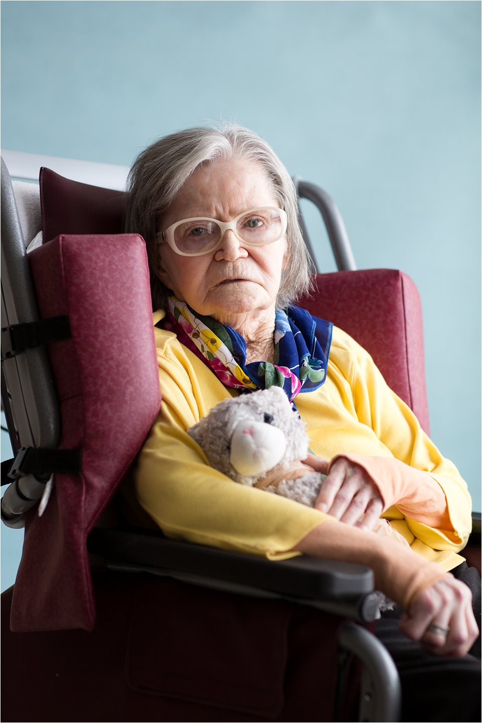 Elderly woman with stuffed animal (C) Maundy Mitchell