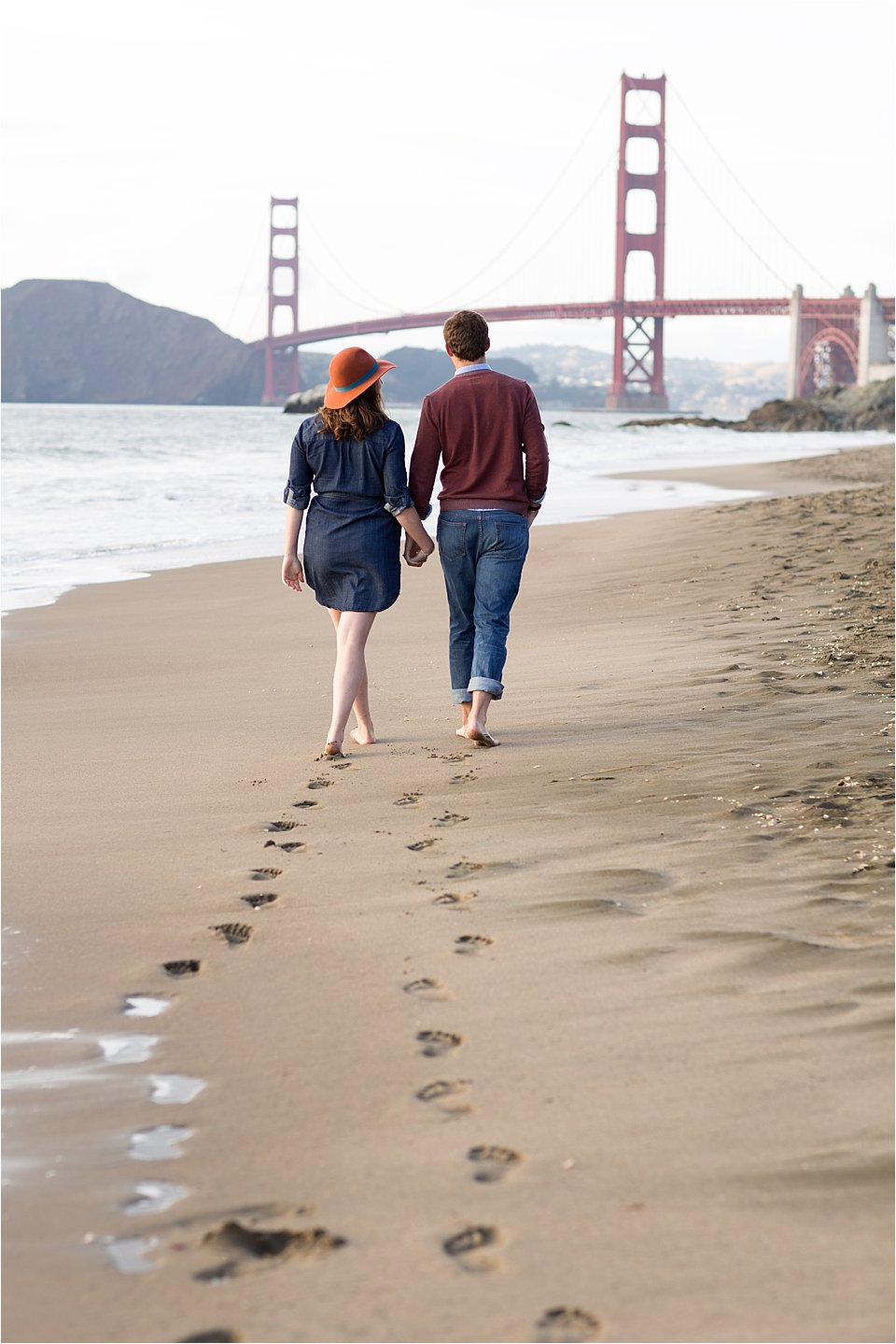 Couple Walking on Beach Golden Gate Bridge