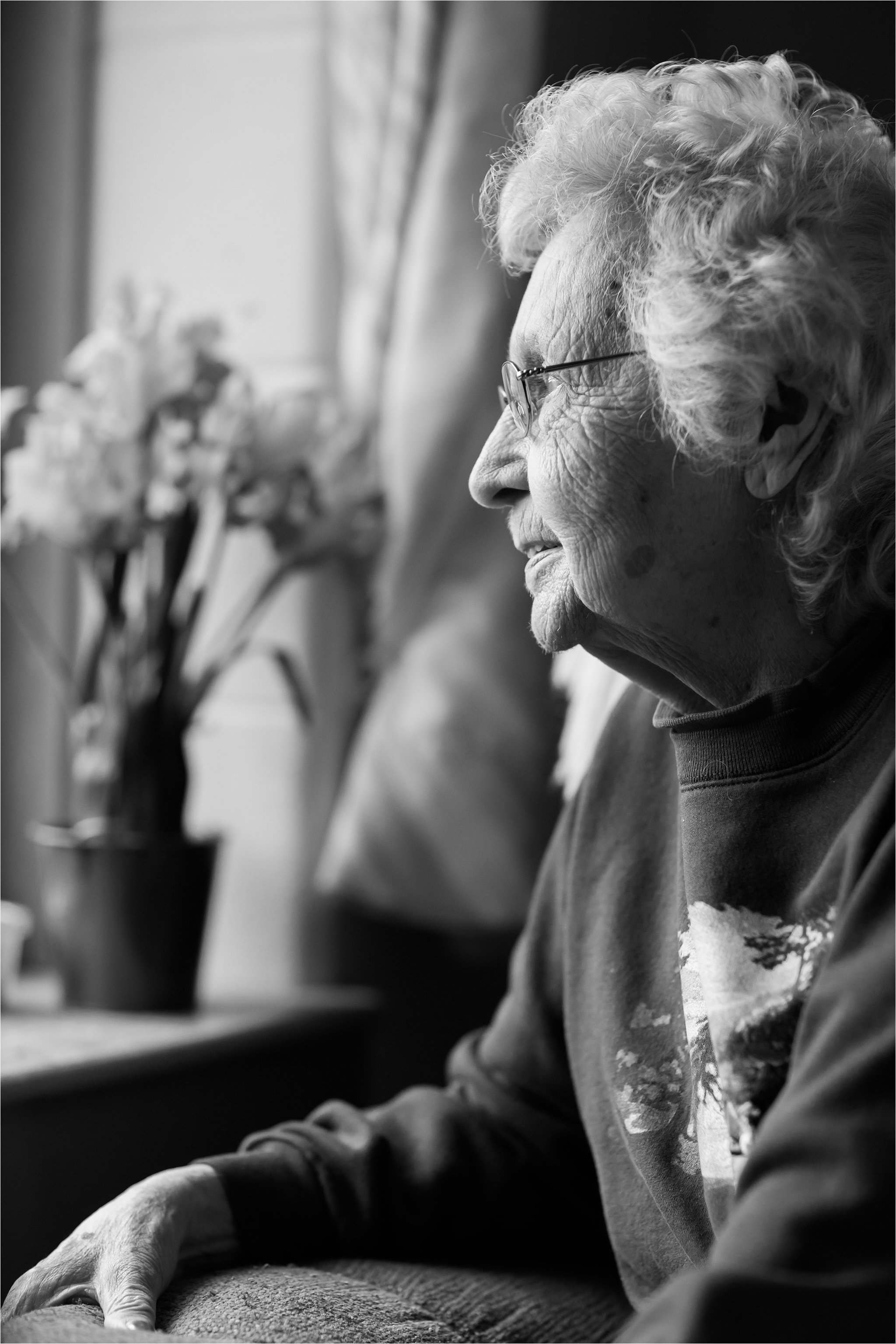 Black and White Portrait of Elderly Woman at Window