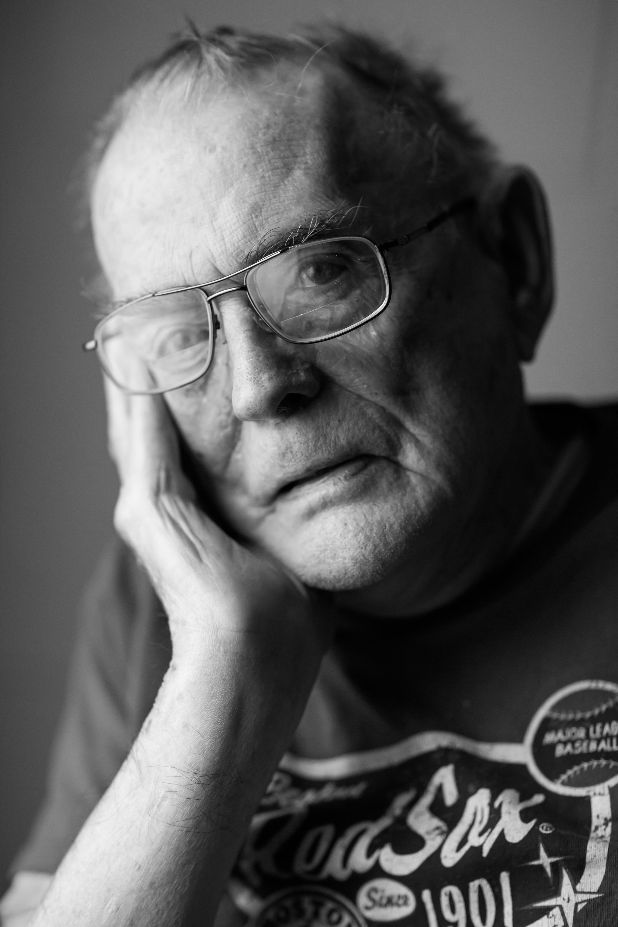 Black and White Portrait of Elderly Man Wearing Red Sox Shirt 2