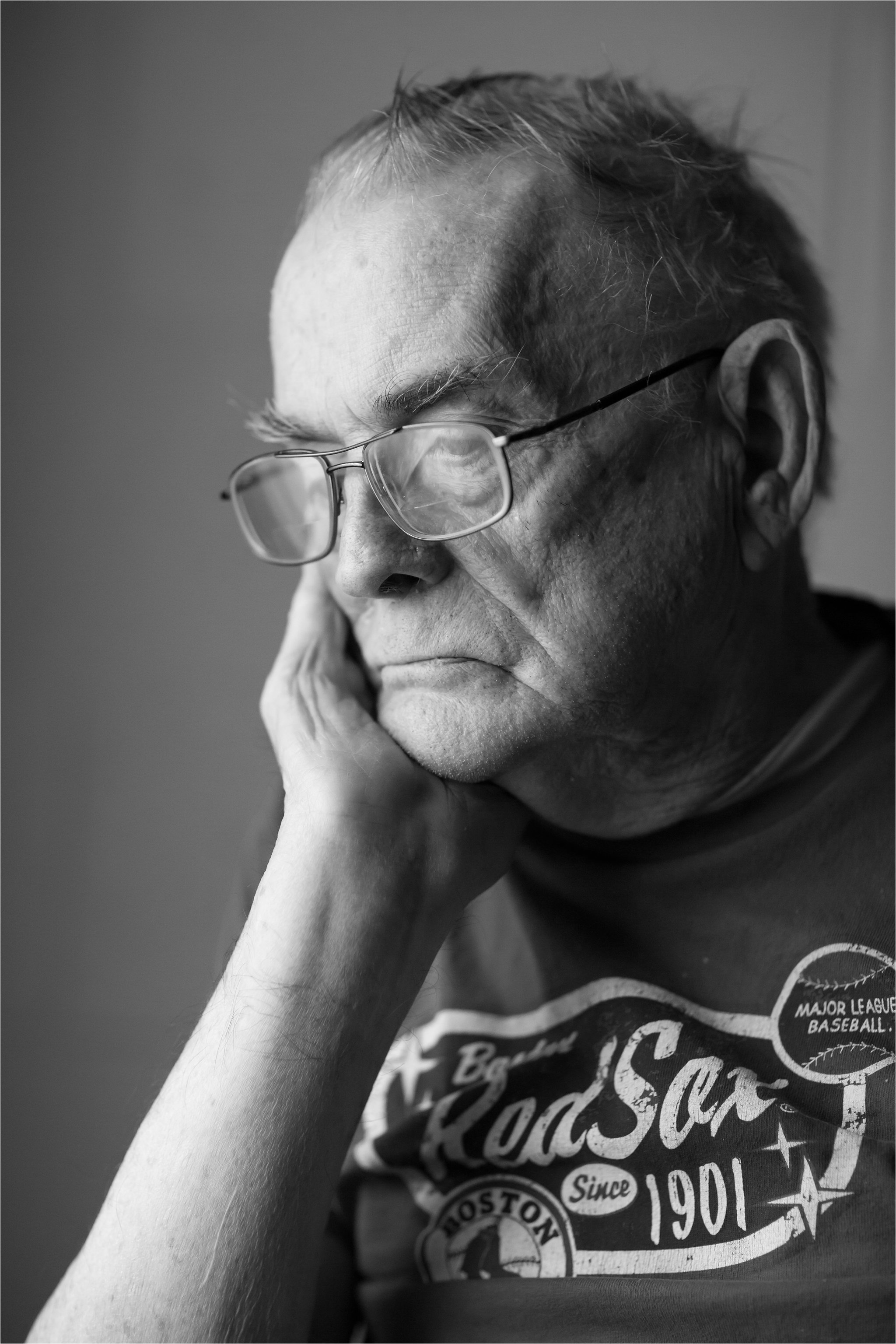 Black and White Portrait of Elderly Man Wearing Red Sox Shirt