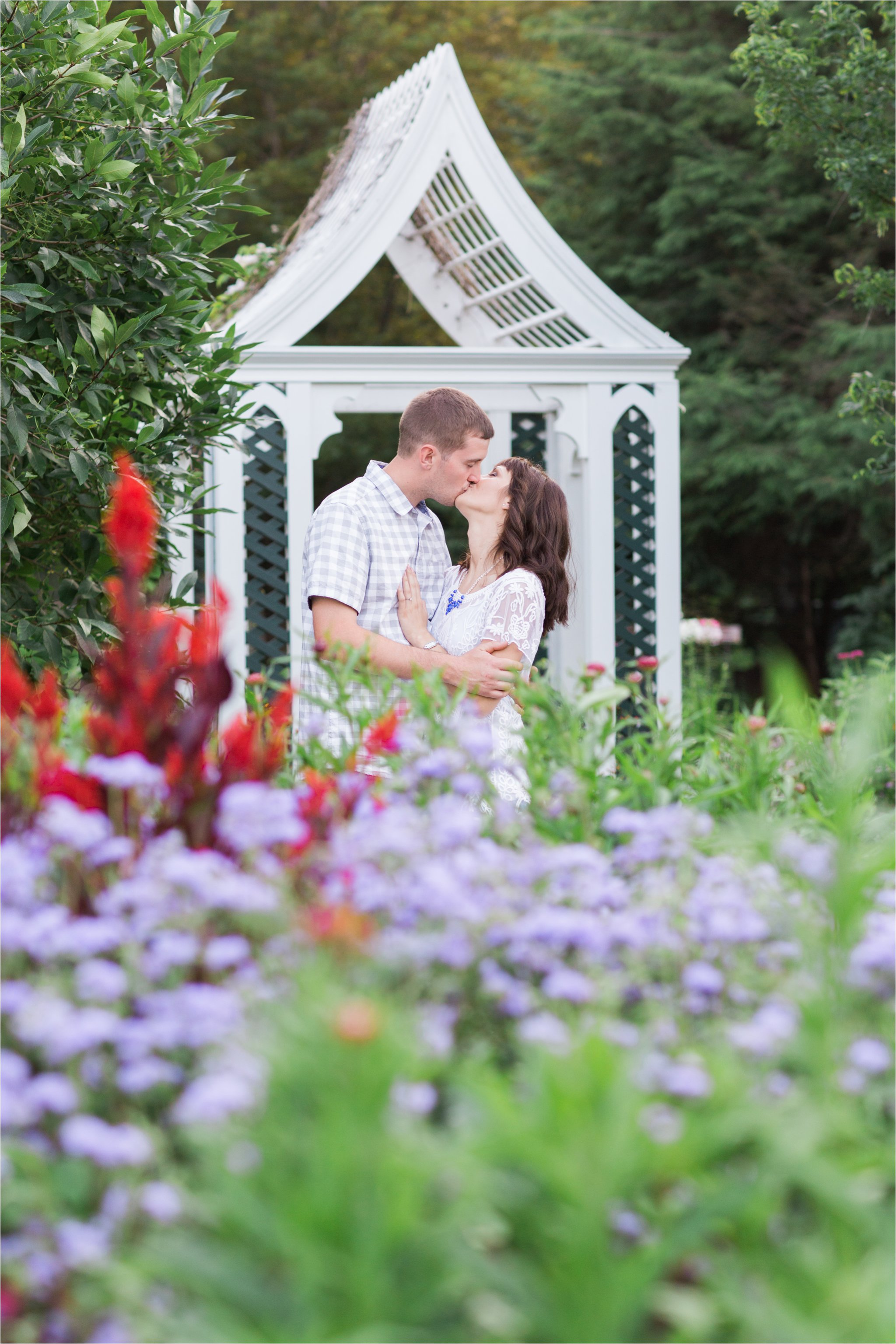 Engaged Couple Kissing in Garden (C) Maundy Mitchell
