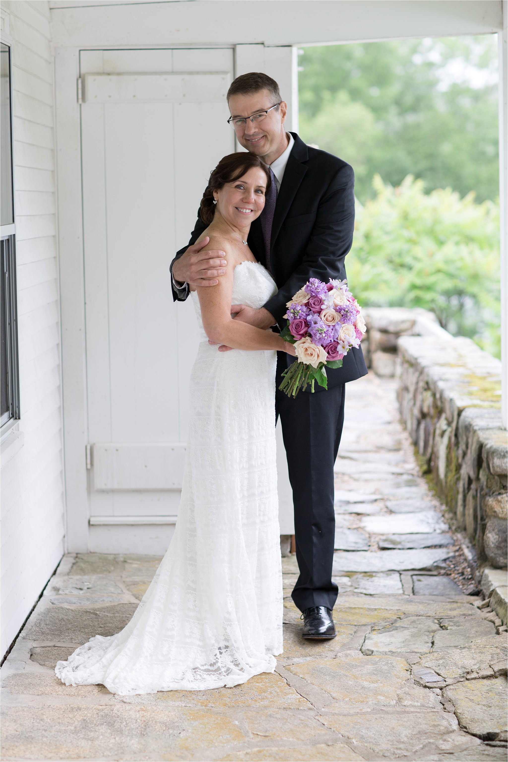 Bride and Groom on Porch (C) Maundy Mitchell