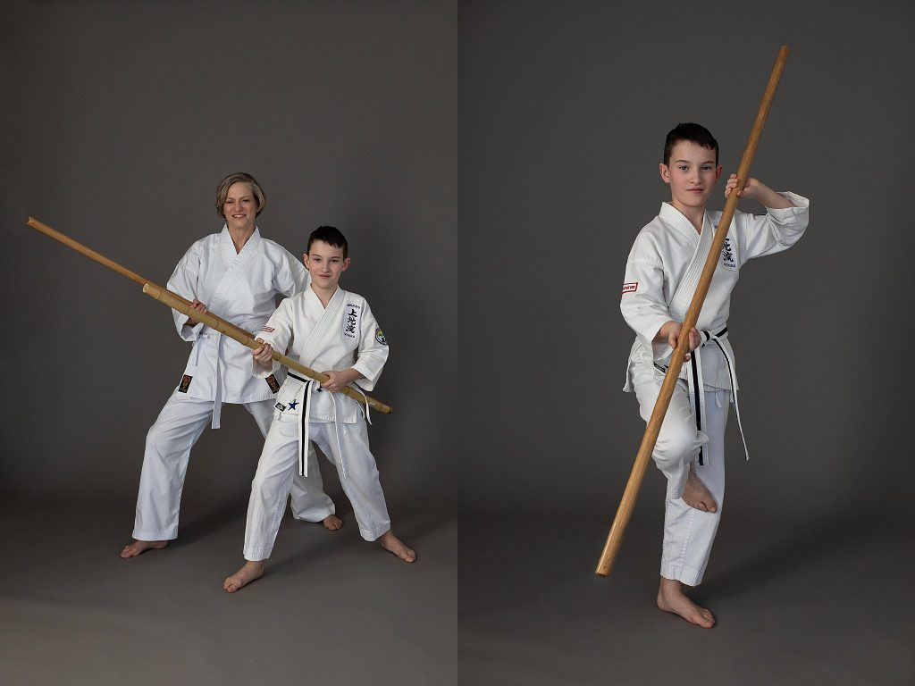 Portraits of a mother and son practicing with the bo (staff) in Uechi Ryu karate