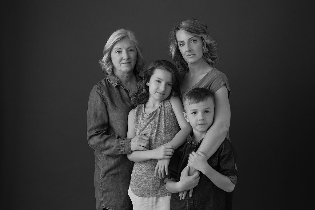Three-generation black and white family portrait