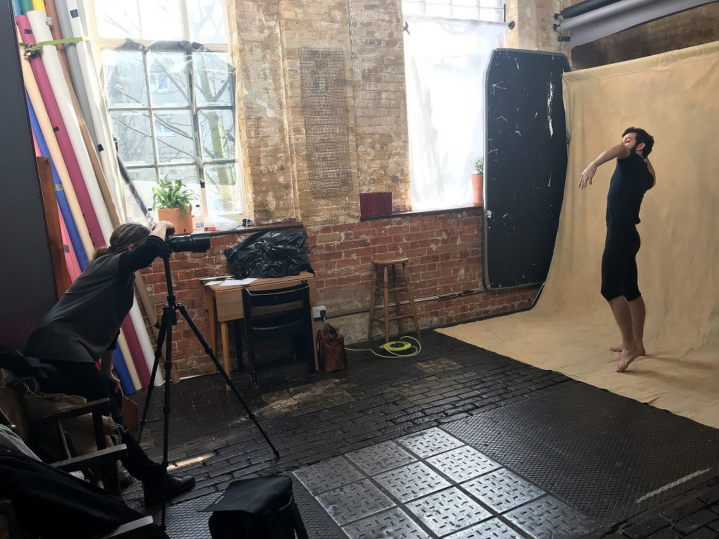 Behind the scenes photo of Maundy Mitchell photographing London mime Ramon Ayres at Espero Studio in London.