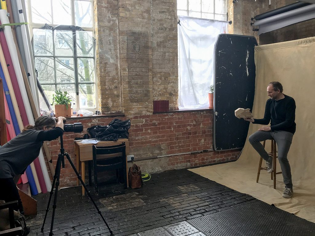 Behind the scenes photo of photographer Maundy Mitchell working with puppeteer Mark Down at Espero Studios in London