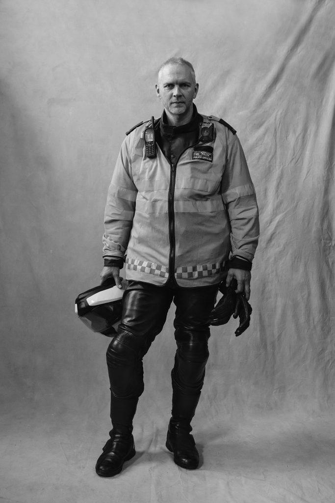 London Traffic Officer Holding Helmet