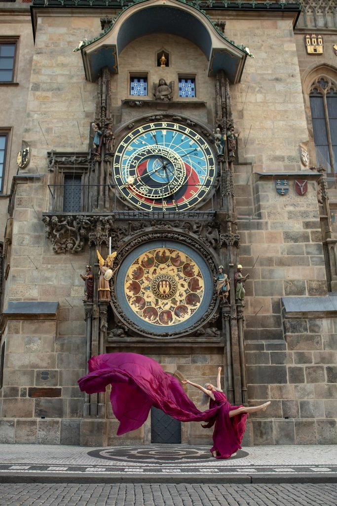 Lisa Travis in front of the medieval Astronomical Clock in Prague