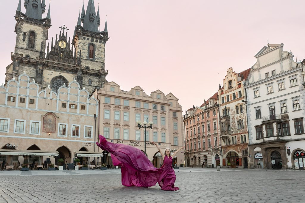 Dancer Lisa Travis in parachute dress in Old Town Square, Prague