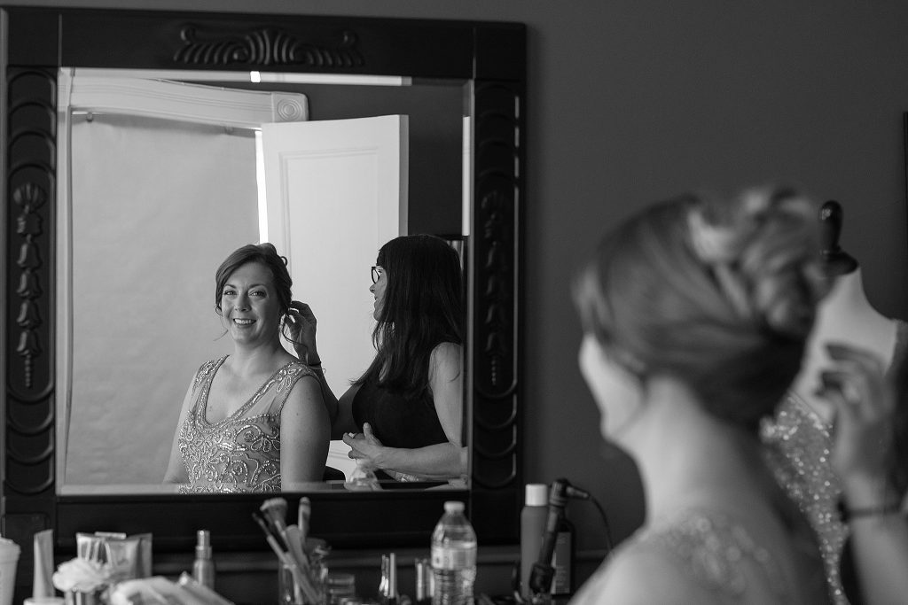 Professional hair and makeup styling is part of the portrait experience.