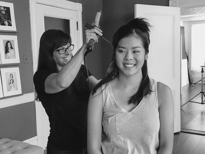 Behind the scenes - professional hair and makeup styling at the beginning of the portrait experience