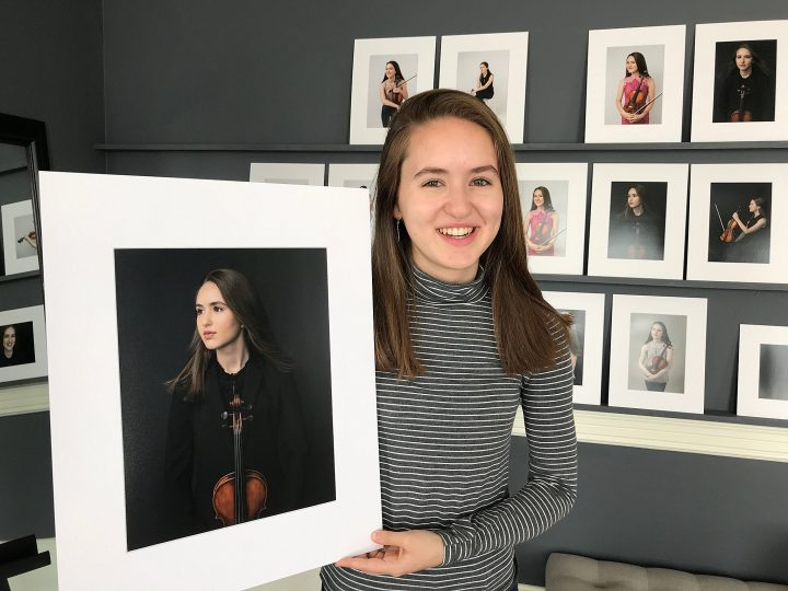 A high school senior with her favorite portraits