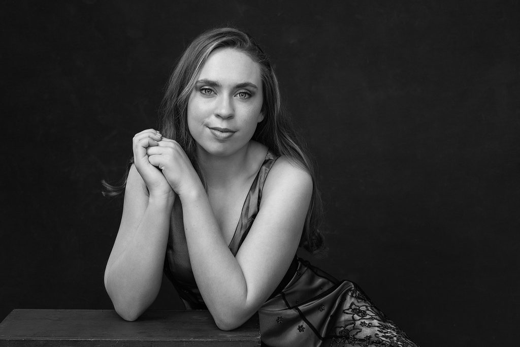 Black and white portrait of Kenzie in tea-length dress