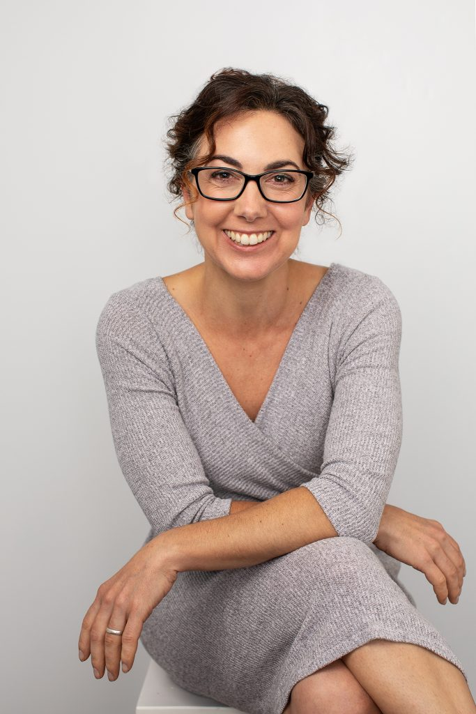 Personal branding portrait of Kayte wearing glasses