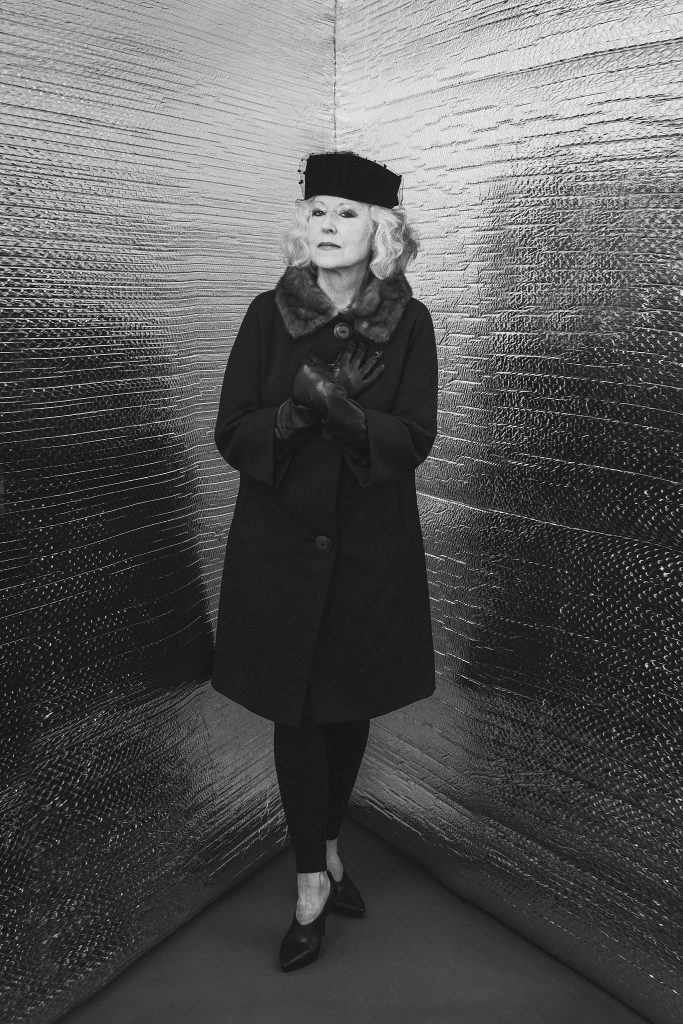 "Modern ""Corner Portrait"" of Hanna wearing a 1960s coat, hat and gloves"