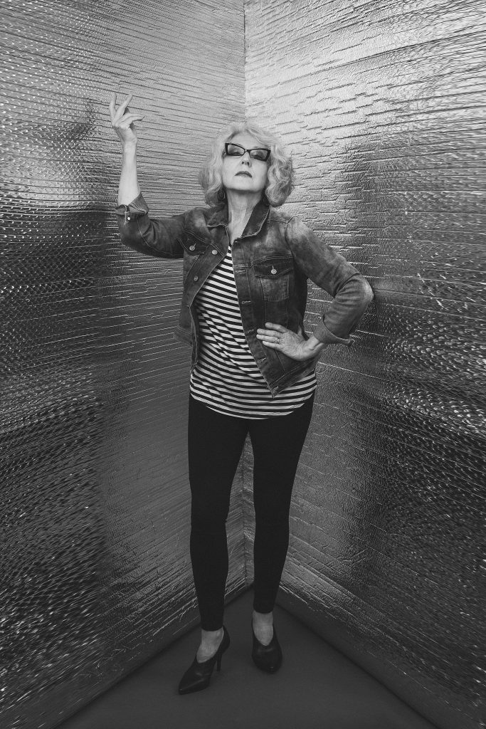 "Modern ""Corner Portrait"" of Hanna in stripes with hand gesture"