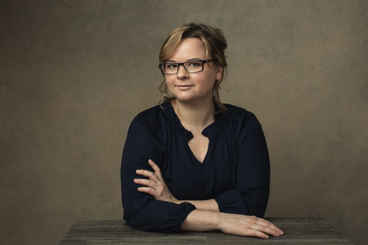 Portrait of Natalie Taylor, owner of Artisan Eyewear, wearing glasses