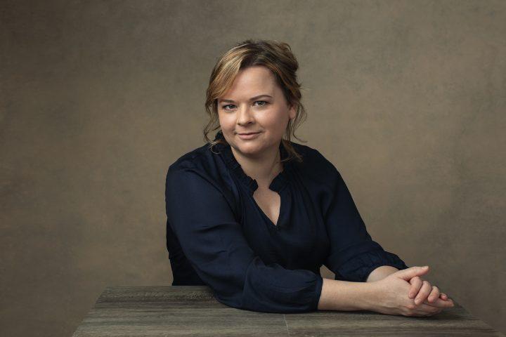 Portrait of Natalie Taylor at desk.