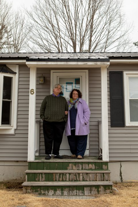 Jonathan and Marcia, outside their home