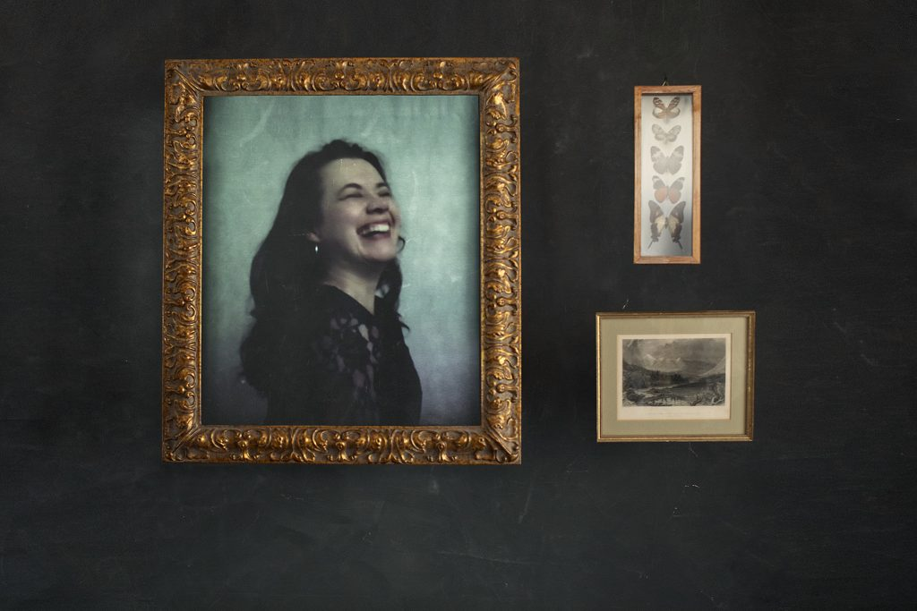 Portrait of Milena, laughing, from her virtual live photo shoot with Maundy Mitchell during the pandemic