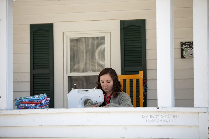 Estee sews masks on her porch