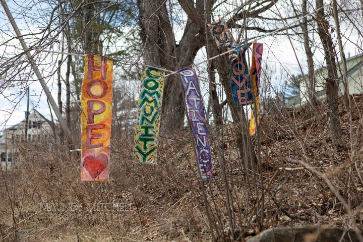 Hand-painted signs of hope by Cynthia Cutting, created to cheer her neighbors