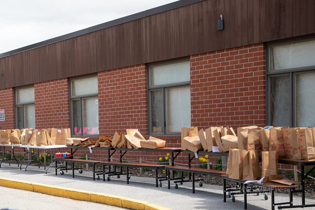 At Campton Elementary School, rows of bags outside are ready for students to pick up.  They contain the contents of each student's locker after it was determined that schools would not reopen.